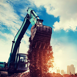 Offroad excavator in the sun